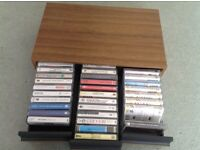 A selection of cassette tapes in box case