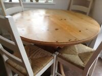 Round solid waxed pine tabl & 4 cream chairs
