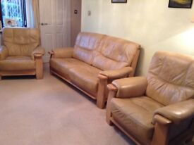 Light antique brown leather suite on wooden frame. Good condition