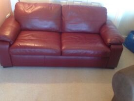 Excellent condition red leather sofa bed 3 seater, 1 seater and foot stool