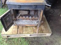 Cast wood burner