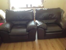 2. Leather brown armchairs