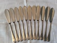 11 Chrome Plated Butter Spreaders.