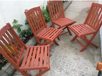 "Four red cedar wooden fold-up Garden chairs. 17""x14"" seat. 85"" chair height."