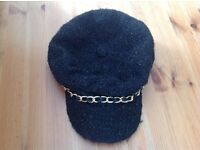 Black hat with gold chain