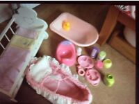 Wooden doll's cot and accessories incl. bath, carry cot, potty, milk bottle, sippy cup etc