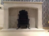 Cast iron fire insert and stone fire place surround