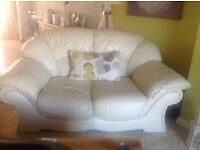 Cream leather 3 piece suite in v.g.c. 2 x two seater sofas 1 x chair