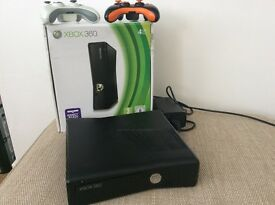 Xbox 360 console and two controllers.