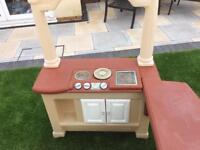 Children's kitchen with tub of accessories and 2bar stools