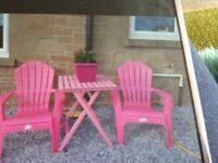 Pink garden chairs and table