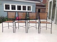 4 x kitchen or conservatory chairs. Black powder coated steel frames with bamboo seat and backs.