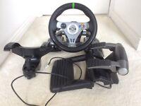 Xbox 360 wireless racing wheel still boxed.