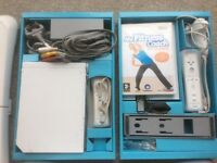 Wii console and 2 Wii Fit boards