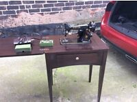 Singer sewing machine built into cupboard