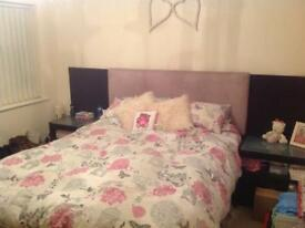 Kingsize bed frame with attached bedside tables and built in lights