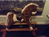 Rocking horse Mamas and Papas £50.00