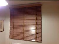 Two oak effect Venetian blinds
