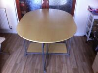 Space saving dining table on wheels, with 4 chairs, all foldable