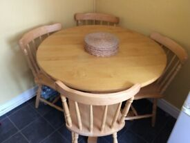 Round Dining table plus 4 chairs - solid wood, excellent condition RRP 180
