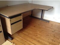 Corner office desk. 2 drawer pedestal. Extra set drawers available. Good condition.