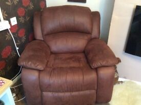 Large comfortable arm chair in flax leather it reclines and rocks