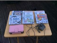 Nintendo DS in pink with games