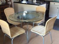 Glass top table(110cm) + 4 chairs ideal for conservatory