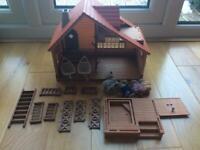 Sylvanian Log cabin and family