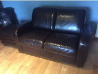 Leather two seater sofa, armchair and foot stool