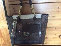 New handbag with dust bag