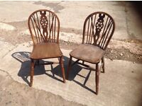 Two matching wooden kitchen chairs