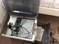 Playstation 1 with storage unit, 2 controllers, 8 games + extras