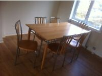 Wood and chrome dining table and 6 chairs