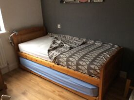 Trundle bed-oak; in good condition