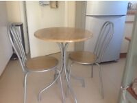 Small round bistro table and 2 chairs