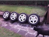 """B m w Alloy wheels 16"""" 225x50x16 2 tyres ok 2 on the limit wheels could do with a refurbished"""
