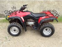 Honda trx350 4x4 quad with gun rack