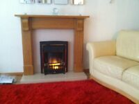 oak fire surround with cream marble inset &hearth &living flame fire