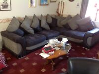 Matching cornet suite and swivel chair in black and gray footstool and cushions vgc buyer collects.