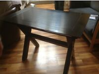 Black lacquered dining table , with glass top