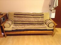 Solid wooden sofa bed.