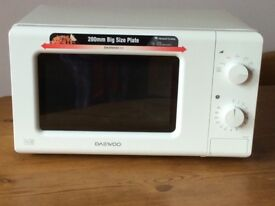 Brand new Daewoo Microwave Oven KOR6M17 still in box. Unwanted gift.