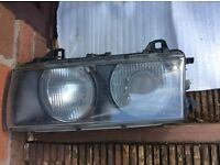 Two BMW head lights of 2003 316