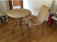 A natural rattan table and chair