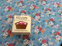 Set of new silicone baking cupcake holders. New never used in original box.