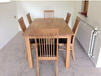 Good as new oak colour dining table with 6 faux brown leather chairs