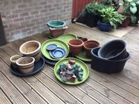 Selection of pottery and plastic planters ect