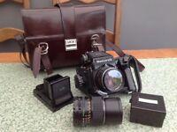 Mamiya medium format film camera and accessories.