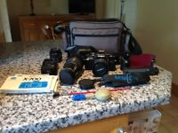 MINOLTA X-700 SLR CAMERA with lenses, flash, accessories and carrying case